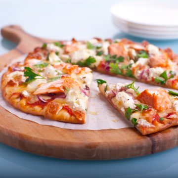 Huon Premium Hot Smoked Salmon pizza with red onions and fetta