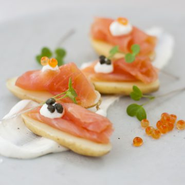 Huon Premium Cold Smoked Salmon on kipfler potatoes with crème fraiche, capers and salmon caviar