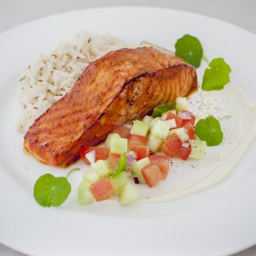 Tandoori salmon portion, spiced rice and cucumber mint salsa