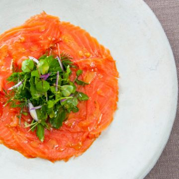 Huon Cold Smoked Ocean Trout 'Carpaccio-style' with torn herbs, lemon zest and pepper dressing