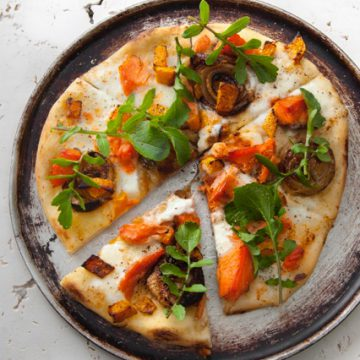 Hot Smoked Ocean Trout pizza with roasted onions, buffalo mozzarella and rocket