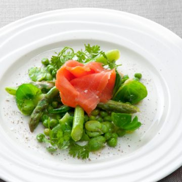 Huon Cold Smoked Ocean Trout with asparagus tips, broad beans and brussel sprout leaves