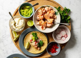 Huon Salmon Tacos, with Avocado, Pickled Red Onion and Lime Crème Fraiche