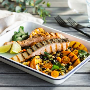 BBQ Huon Salmon with grilled peach, black bean and corn salad