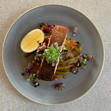 Huon Salmon with Roasted Red Onion & Capsicum Ragout and Grape, Currant & Pinenut Salsa