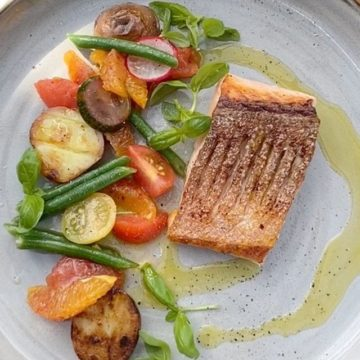 Huon Salmon with olive oil poached tomato summer salad